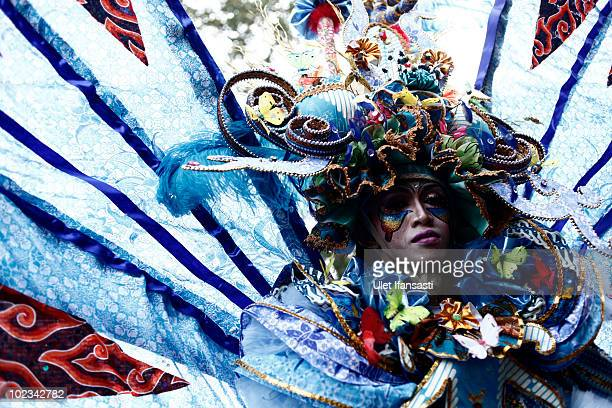 A model parades a costume made from traditional batik cloth during the third Solo Batik Carnival on June 23 2010 in Surakarta Indonesia The carnival...