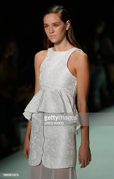 Model parades a creation by designer Faddoul during the New Generation parade at the Mercedes-Benz Fashion Week Australia in Sydney on April 12,...