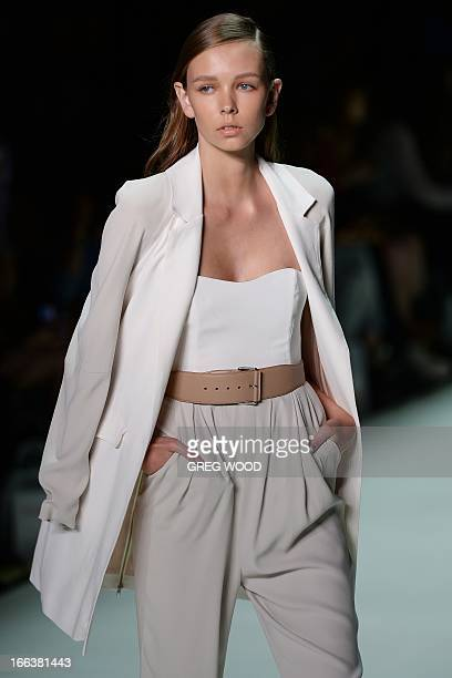 Model parades a creation by designer Tristan Melle during the New Generation parade at the Mercedes-Benz Fashion Week Australia in Sydney on April...