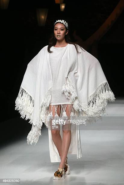 A model parades a creation from Qing's Zheng Qinger Collection designed by Zheng Qinger at China Fashion Week in Beijing on October 26 2015 AFP PHOTO...
