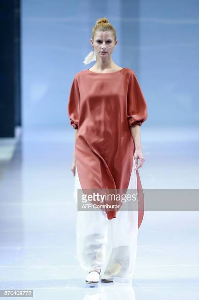 A model parades a creation from the 'Day Broadcast' collection by Fu Suqin during China Fashion Week in Beijing on November 5 2017 / AFP PHOTO / STR...