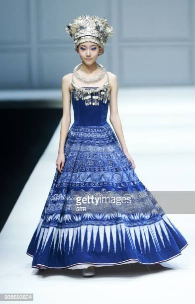 A model parades a creation from the GUYS collection by designer Cheng Hao during China Fashion Week in Beijing on March 27 2018 / AFP PHOTO / STR /...