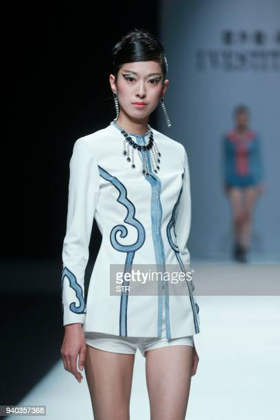 A model parades a creation from the 'I VESTITI YJ' collection by designer Yu Jia during China Fashion Week in Beijing on March 31 2018 / AFP PHOTO /...