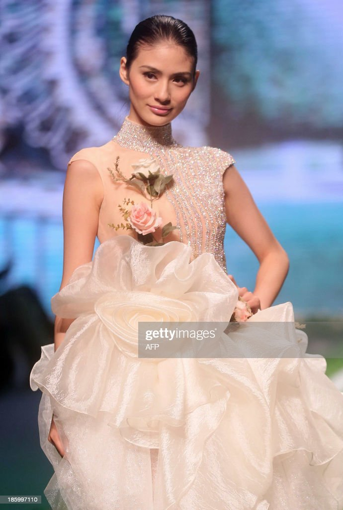 A model parades a creation of the Famory Cai Zhonghan Wedding Dress Collection during China Fashion Week in Beijing on October 27, 2013. China Fashion Week runs from October 25 to November 1. CHINA