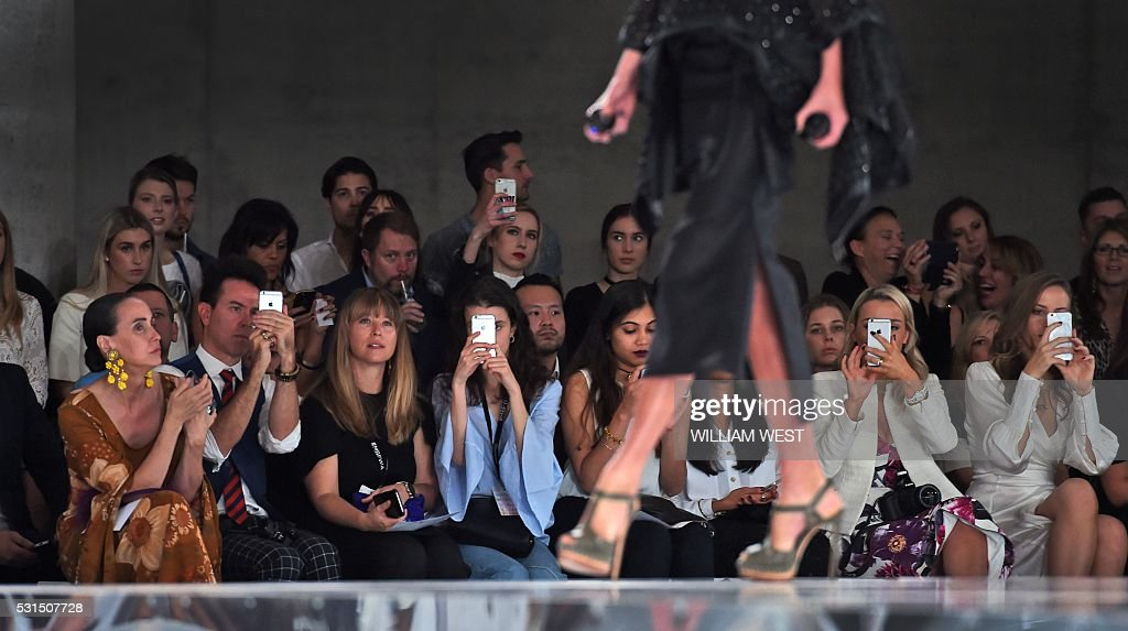 A model parades a creation on the runway by Australian designer Toni Maticevski at Fashion Week Australia in Sydney on May 15, 2016. / AFP / WILLIAM