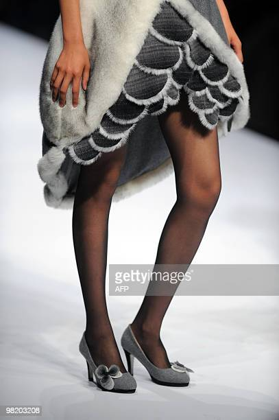 Model parades a fashion creation during the Cherry Cup 15th New Fashion Designers Award during China Fashion Week in Beijing on March 30, 2010. The...