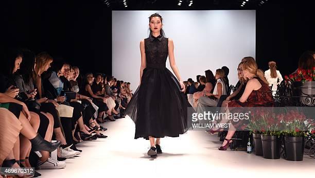 A model parades a garment by Australian designer Jayson Brunsdon during a parade at Fashion Week Australia in Sydney on April 14 2015 AFP PHOTO /...