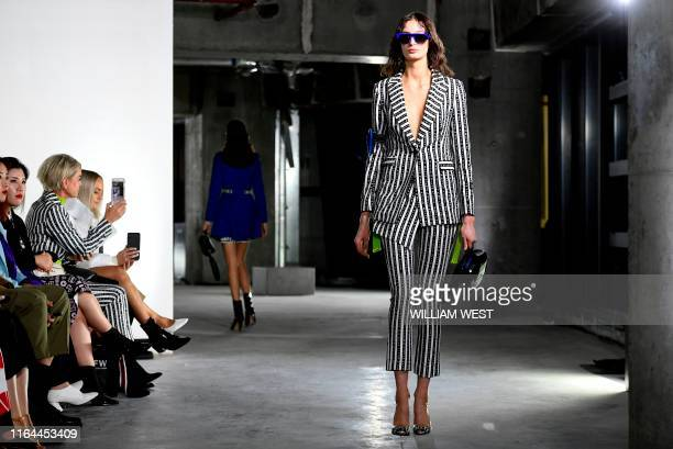 A model parades a garment by label Whyte Studio during Melbourne Fashion Week in Melbourne on August 28 2019