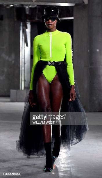 Model parades a garment by label Whyte Studio during Melbourne Fashion Week in Melbourne on August 28, 2019.