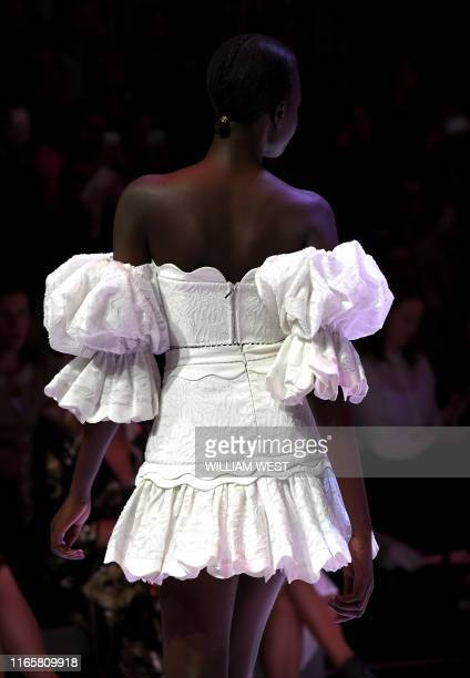Model parades a garment by the label Acler during Melbourne Fashion Week in Melbourne on September 3, 2019.
