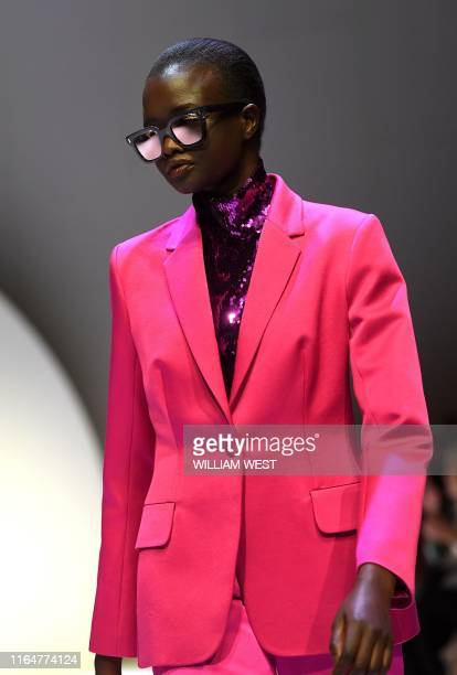 Model parades a garment from the label Martin Grant during Melbourne Fashion Week in Melbourne on August 30, 2019.