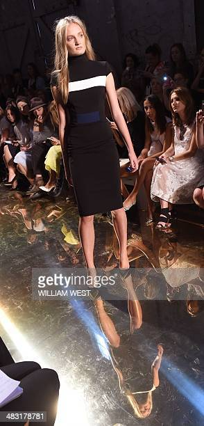 A model parades an outfit by Australian designer Alex Perry during the showing of his collection at Fashion Week Australia in Sydney on April 7 2014...