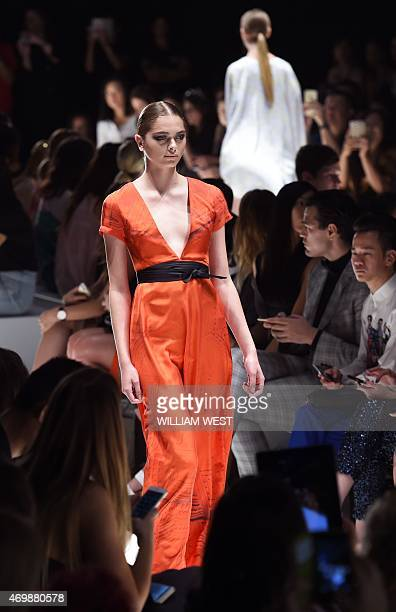 Model parades an outfit by Australian fashion label House of Cannon during the New Generation Show at Fashion Week Australia in Sydney on April 16,...