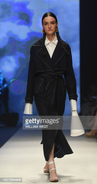 A model parades an outfit by Australian label Anna Quan during Melbourne Fashion Week on September 6 2018
