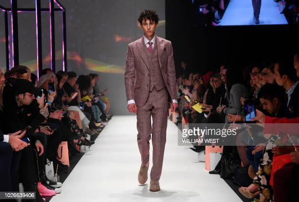 Model parades an outfit by Australian label Dom Bagnato during Melbourne Fashion Week on September 4, 2018.