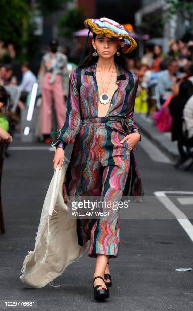 Model parades an outfit by Australian label North during Melbourne Fashion Week in Melbourne on November 25, 2020.