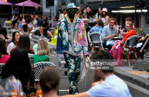 Model parades an outfit by Australian label Reborn By Home during Melbourne Fashion Week in Melbourne on November 25, 2020.
