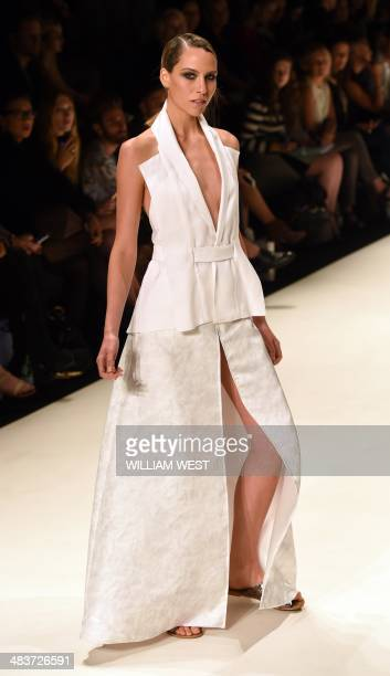 A model parades an outfit by designer Julia Logvin during a showing of her label Logvin Code at Fashion Week Australia in Sydney on April 10 2014 The...