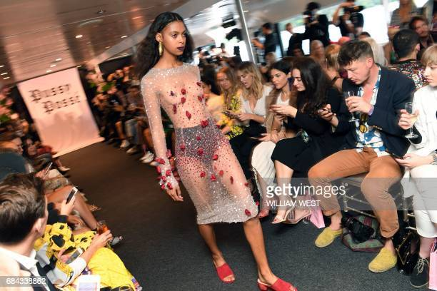 A model parades an outfit by fashion label Dyspnea during Fashion Week Australia in Sydney on May 18 2017 / AFP PHOTO / William WEST