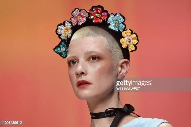 A model parades an outfit from Australian department store David Jones during Melbourne Fashion Week on September 3 2018