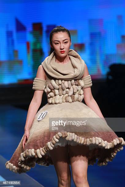 A model parades creations during the Hempel Award the 23rd China International Young Fashion Designers Contest at China Fashion Week in Beijing on...