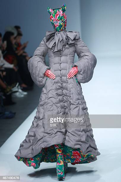 A model parades creations during the Sheguang Hu Collection at China Fashion Week in Beijing on March 25 2015 The biannual China Fashion Week is...