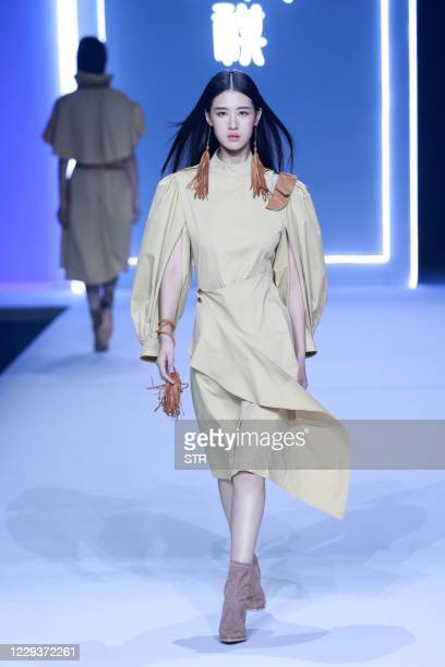 Model parades in a creation from the Shangguchuanqi collection by Xinyu Lu during China Fashion Week in Beijing on October 31, 2020. / China OUT