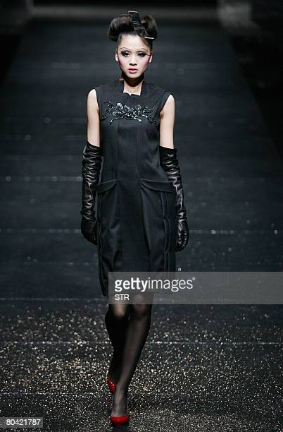 Model parades the latest fashion by Chinese designer Qi Gang's ready-to-wear collection at the China Fashion Week Autumn/Winter 2008-2009, in Beijing...