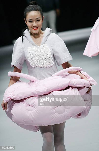 Model parades the latest fashion by young Chinese designers at the China Fashion Week Autumn/Winter 2008-2009, in Beijing on March 25, 2008. The...