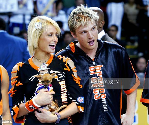 Model Paris Hilton and boyfriend singer Nick Carter attend the NBA AllStar Celebrity Game on February 13 2004 at the Los Angeles Convention Center in...