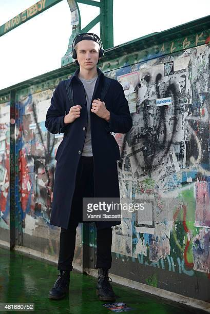Model Patrick Dooley poses wearing a Crombie coat Topman shirt and pants and Dr Martens boots on January 17 2015 in Milan Italy