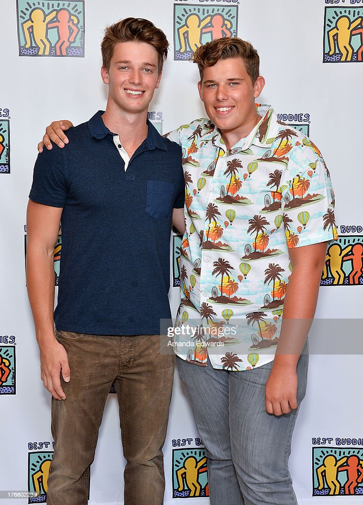 Model Patrick Schwarzenegger (L) and his brother Christopher Schwarzenegger attend the Team Maria benefit for Best Buddies at Montage Beverly Hills on August 18, 2013 in Beverly Hills, California.