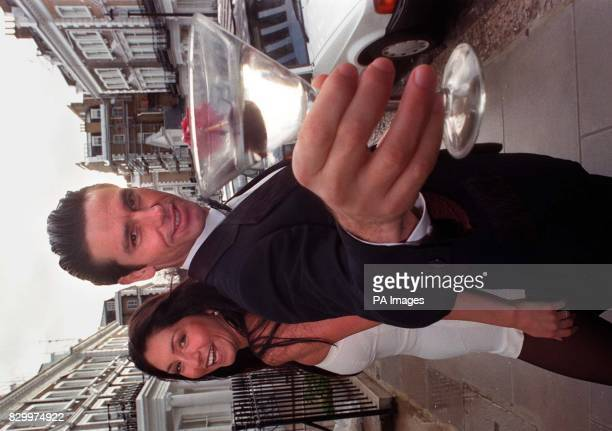 Model Paul Baldwin shaken but not stirred as he sports a dress suit made for actor Sean Connery in the 1971James Bond film Diamonds Are Forever as...