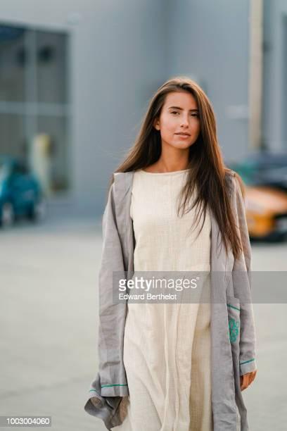 Model Paula Florea wears a gray jacket a beige dress during Feeric Fashion Week 2018 on July 20 2018 in Sibiu Romania