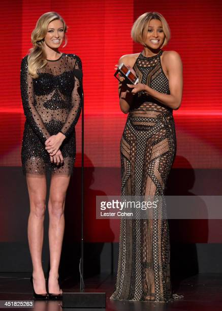 Model Paulina Gretzky and recording artst Ciara speak onstage during the 2013 American Music Awards at Nokia Theatre LA Live on November 24 2013 in...