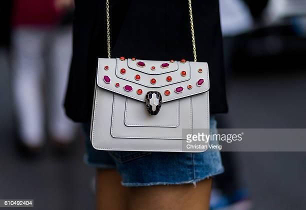 Model Pauline Hoarau wearing a Bulgari bag outside Trussardi during Milan Fashion Week Spring/Summer 2017 on September 25 2016 in Milan Italy