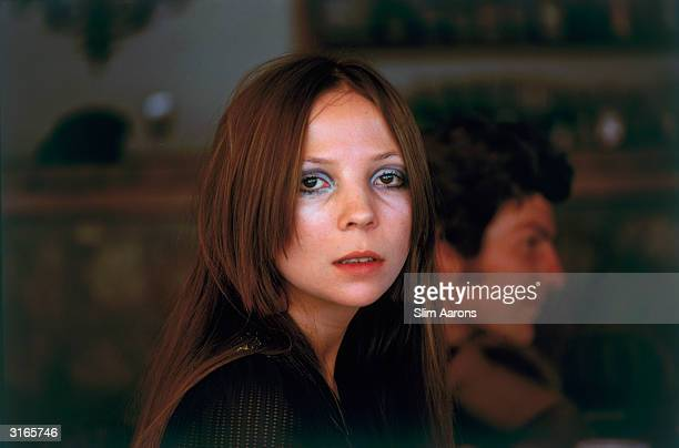 Model Penelope Tree at Capri In the background can be seen the photographer Patrick Lichfield Earl of Lichfield