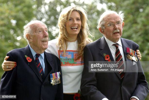 Model Penny Lancaster with George Cross recipient Colonel Stuart Archer OBE 89 a pioneer of British bomb disposal and Colnel Eric Wilson one of only...
