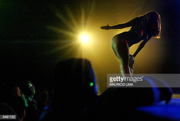 A model performs a striptease show during Erotika Fair in Sao Paulo Brazil late 21 April 2004 The event the biggest of its kind in Latin America and...