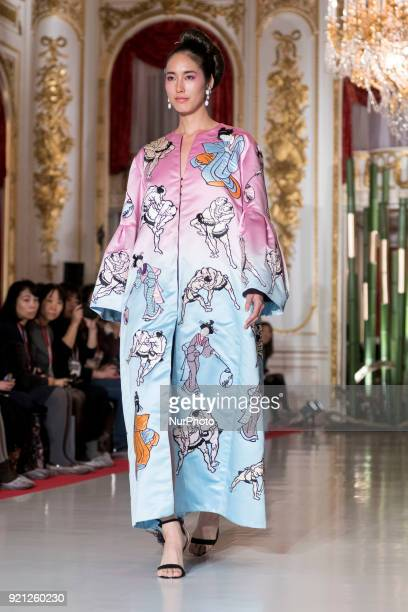 A model performs creations of Fashion Designer Yumi Katsura for BEYOND EAST ampWEST collection in Tokyo on February 20 2018 This event is designed to...