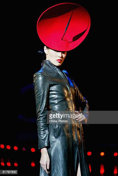 A model performs during a hats and accessories show by British designer Philip Treacy during the 2004 Lycra Channel Young InStyle Awards on November...