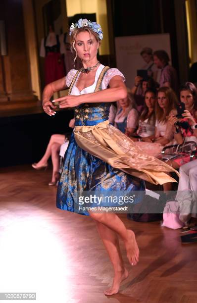 A model performs during 'POMPOEOES By Angermaier Collection Presentation' at Deutsches Theatre on August 21 2018 in Munich Germany
