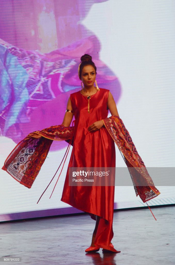 Model performs on stage wearing traditional outfits during the China Ancient Show of CPEC Cultural Caravan Festival in Lahore