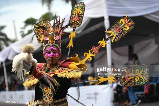 A model performs with a chicken during Pets Carnival as part of the 18th Jember Fashion Carnival 2019 on August 01 2019 in Jember Indonesia The 18th...