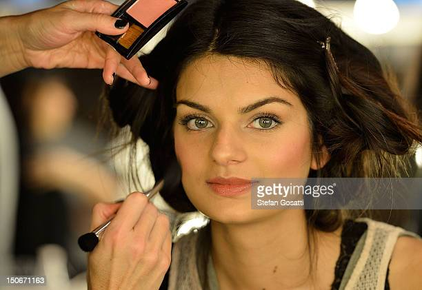 A model perpares backstage ahead of the Cotton On show as part of the MercedesBenz Fashion festival Sydney 2012 on August 24 2012 in Sydney Australia