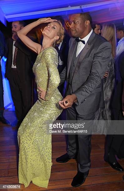 Model Petra Nemcova and actor Chris Tucker attend the after party at amfAR's 22nd Cinema Against AIDS Gala Presented By Bold Films And Harry Winston...