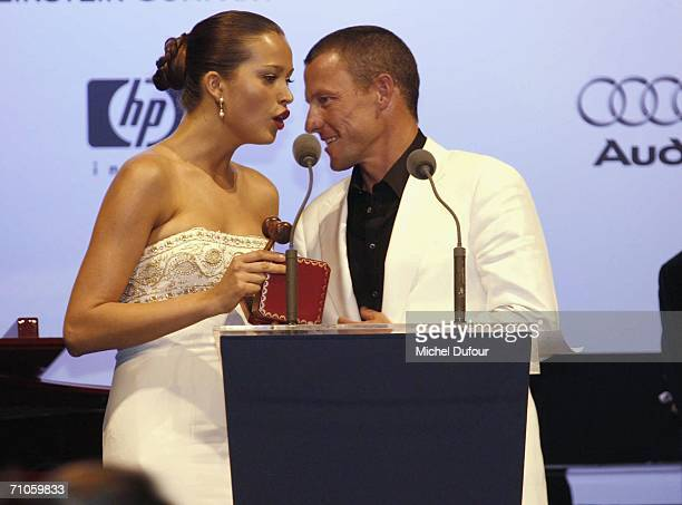 """Model Petra Nemcova and Cyclist Lance Armstrong participate in the auction at """"Cinema Against AIDS 2006"""", the annual event in aid of amfAR at Le..."""