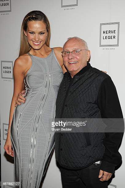 Model Petra Nemcova and designer Max Azaria pose backstage at the Herve Leger By Max Azria fashion show during MercedesBenz Fashion Week Fall 2014 at...