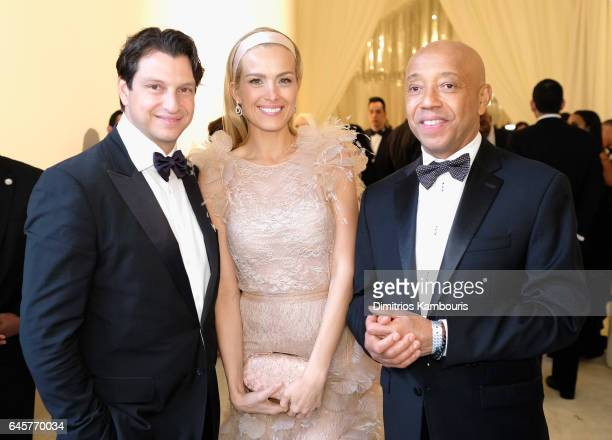 Model Petra Nemcova and entrepreneur Russell Simmons attend the 25th Annual Elton John AIDS Foundation's Academy Awards Viewing Party at The City of...