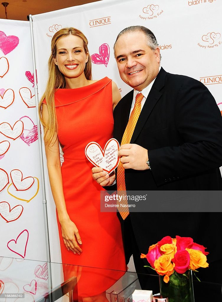 Model Petra Nemcova and Senior Vice President of Clinique Ricardo Quintero (R) attend Happy Hearts Fund In Partnership With Clinique Launch Event at Bloomingdale's 59th Street Store on December 14, 2012 in New York City.